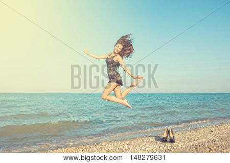 Young Cheerful Girl On The Sea