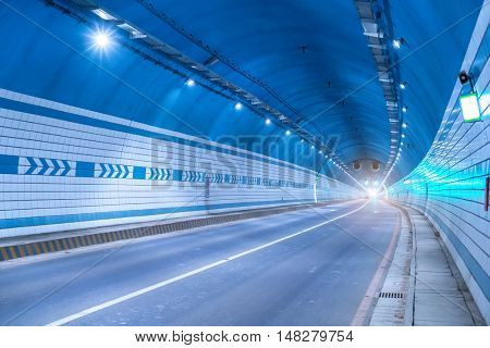 Car driving on to tunnel.