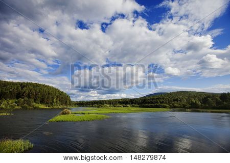 River in the Urals Mountains in Russia. Cloudy sky