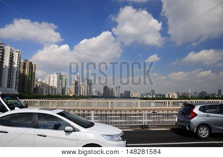 June 23 2016. Guangzhou China. Traffic moving over a bridge in the city of Guangzhou China on a low pollution blue sky day.