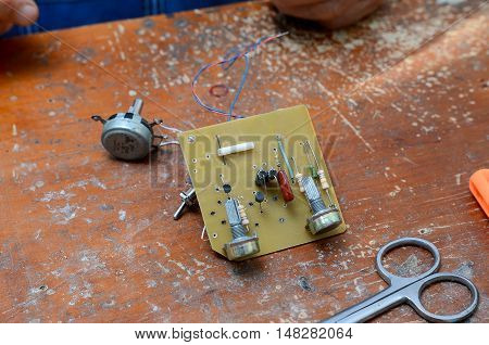 board chip resistor, transistor, on a table