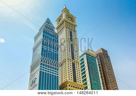 Dubai, UAE - May 1, 2013: Al Yaqoub Tower, Capricorn Tower, Al Rostamani Maze Tower on Sheikh Zayed Road in Downtown of Dubai. Maze Tower overlooks the Dubai International Financial Centre.
