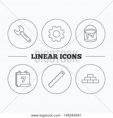 Brickwork, measurement and adjustable wrench icons. Bucket of paint linear sign. Flat cogwheel and calendar symbols. Linear icons in circle buttons. Vector