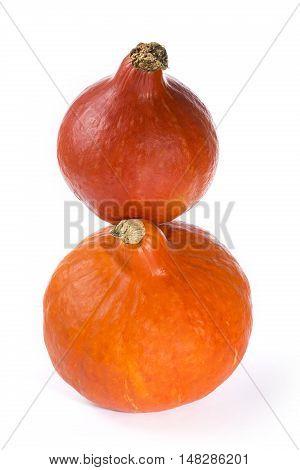 Two orange Hokkaido pumpkin on a white background
