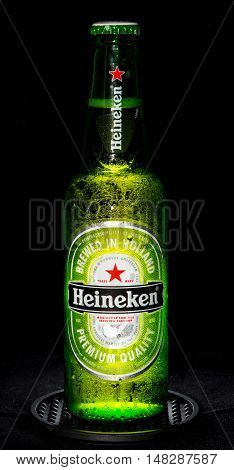 Shot of a Heineken bottle taken out of the fridge