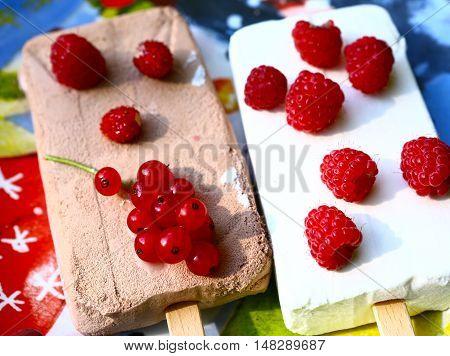 sundae ice cream chokolate and cream with berries on plate