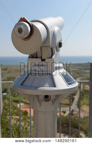 Telescope for panoramic views token for tourist use