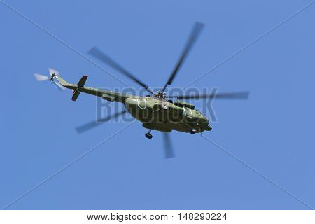 Helicopter flying in the sky in search of people