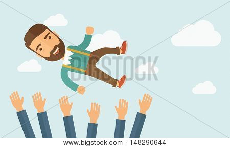 A successful smiling hipster Caucasian businessman with beard being throwing up to the sky by his teamwork or colleague. Happiness concept. A contemporary style with pastel palette soft blue tinted