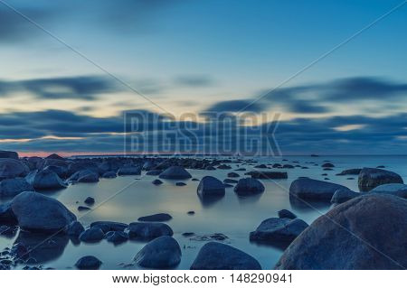 After sunset, Baltic sea stones and clouds