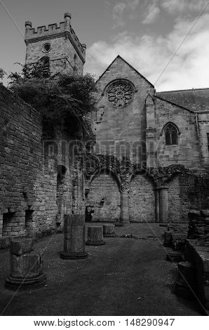 A view of the ruins of Culross abbey and the church behind