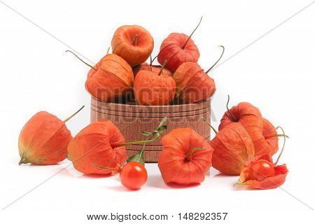 physalis in wooden bowl isolated on white background.