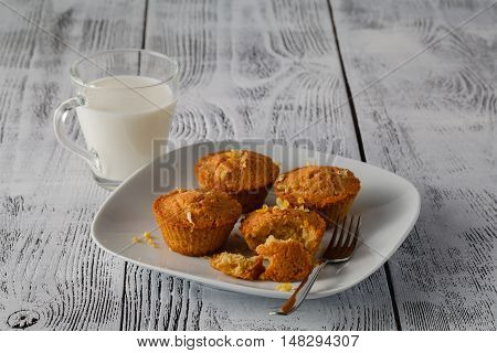 fresh mini muffins on plate with milk
