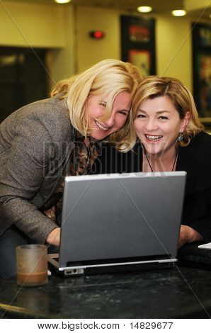 two happy mature senior business  woman work on laptop computer
