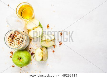 Selection of ingredients for cooking the traditional autumn apple crumble, top view, copy space