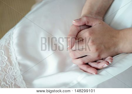 Hands Of Beautiful Bride In White Dressing Gown. Beauty Model Girl In Wedding Robe. Female Portrait