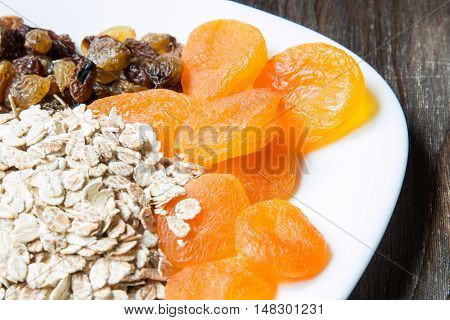 Uncooked oatmeal with raisins and dried apricots