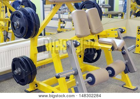 Interior of a fitness hall with wights and other sport equipment