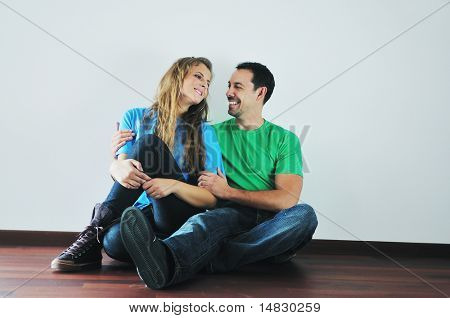 happy young cuple have fun and relax in their new big bright home apartment