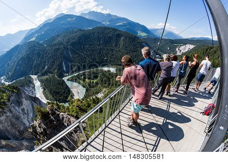 FLIMS SWITZERLAND - SEPTEMBER 10 2016: People on the platform Il Spir near Flims on September 9 2016. The platform provides a beautiful overlook to the Rhine Valley in the canton Graubunden.