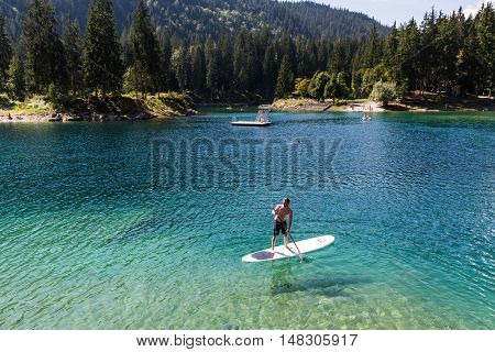 Man On A Paddleboard At Caumasee, Switzerland