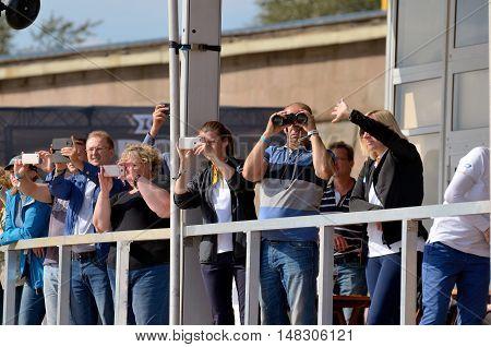 02.09.2016.Russia.Saint-Petersburg.Spectators watch the regatta.Someone looking through binoculars.