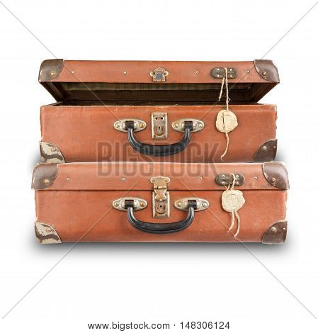 Set of old isolated on white background suitcases. A pile of luggage