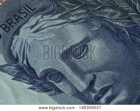 Close-up of brazilian currency notes detail face