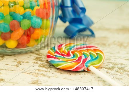 Nice glass container with blue ribbon filled candies