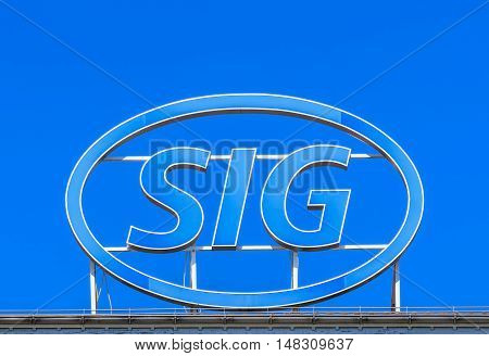 Neuhausen am Rheinefall, Switzerland - 22 June, 2016: SIG sign on the top of the SIG building. SIG is the abbreviation for German