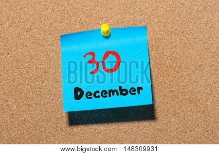 December 30th. Day 30 of month, Calendar on cork notice board. New year at work concept. Winter time. Empty space for text.