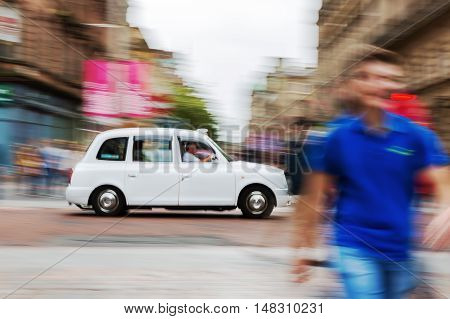 Traditional London Taxi Cab In Motion Blur