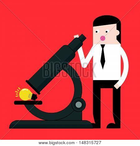 Businessman Use Microscope To Discovery Idea