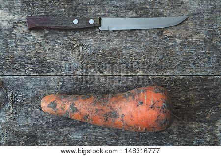 Kitchen Knife And Dirty Carrot