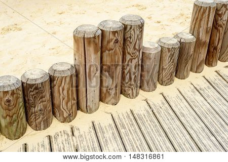 Wooden Poles And Sandpit