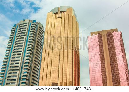Dubai, United Arab Emirates - May 1, 2013: modern colorful shiny facades of high rise buildings in Downtown Dubai district, United Arab Emirates. Futuristic background and modern skyscrapers.