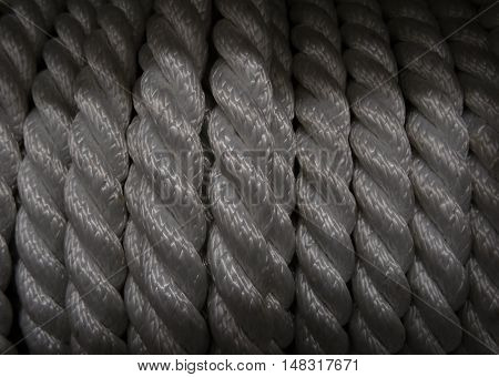 Bobbin of white synthetic rope texture macro shot