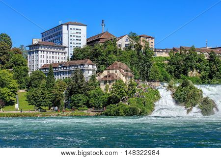 Neuhausen am Rheinfall, Switzerland - 22 June, 2016: buildings at the Rhine Falls. Neuhausen am Rheinfall is a municipality in the Swiss canton of Schaffhausen, known for the Rhine Falls - the largest plain waterfall in Europe.