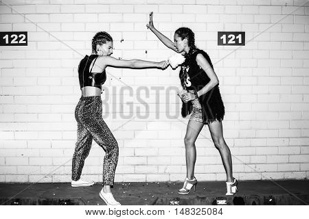 Two Young Women Arguing. Outdoor Girls Portrait