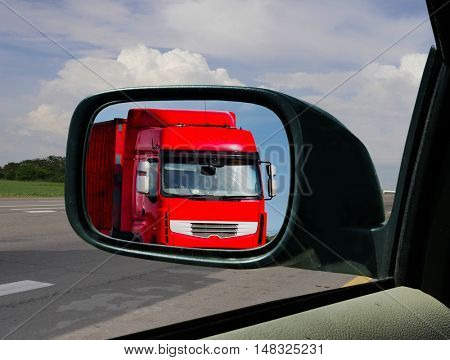 Truck in the rearview mirror. overtaking Maneuver