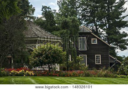 Beautiful country wooden house with pavilion and trees