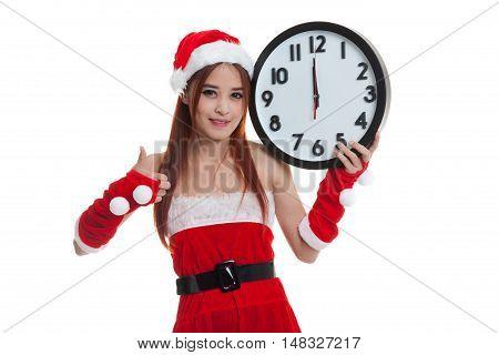 Asian Christmas Santa Claus Girl  Thumbs Up With Clock At Midnight.