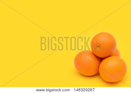 The mandarines isolated on a yellow background.
