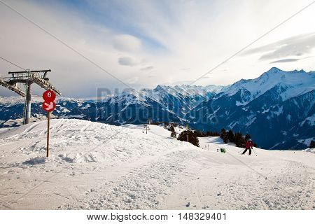 Red route sign on the ski resort in Alps mountains in Mayerhofen, Austria