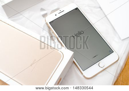PARIS FRANCE - SEP 16 2016: New Apple iPhone 7 Plus unboxed in the first day of sales - Hello text on first run. New Apple iPhone claims to become the most popular smart phone in the world in 2016