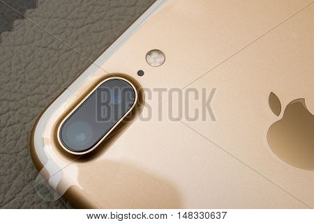 PARIS FRANCE - SEP 16 2016: New Apple iPhone 7 Plus unboxed in the first day of sales - two camera lenses and plastic film on phone. New Apple iPhone 7 claims to become the most popular smart phone in the world in 2016