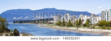 Panorama view of Vancouver's English Bay and Sunset Beach Park with it many apartments and condominiums along the shoreline. A hughly popular area just outside of the city center. Shot from the Burrard Bridge