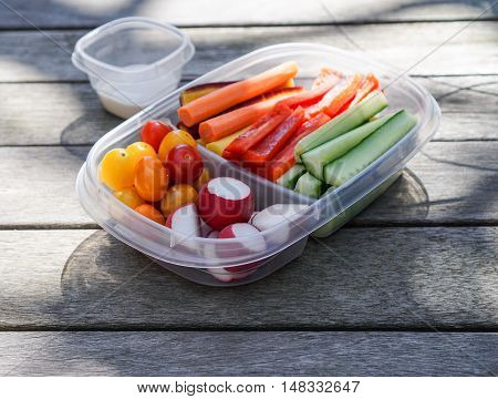 Vegetable platter/ crudités, vegetables in plastic container, healthy eating concept
