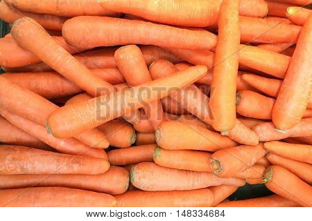 Background of fresh carrots on a market.