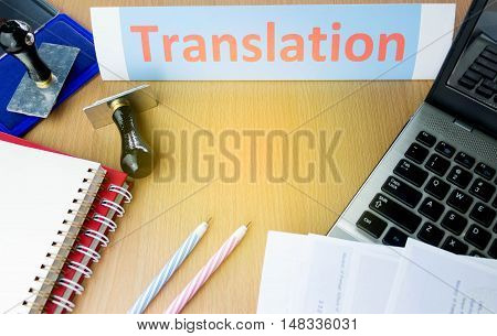 orange translation word on office table with copyspace
